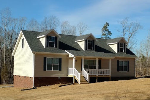 Cape Cod with optional brick, shed porch, gutters, downspouts